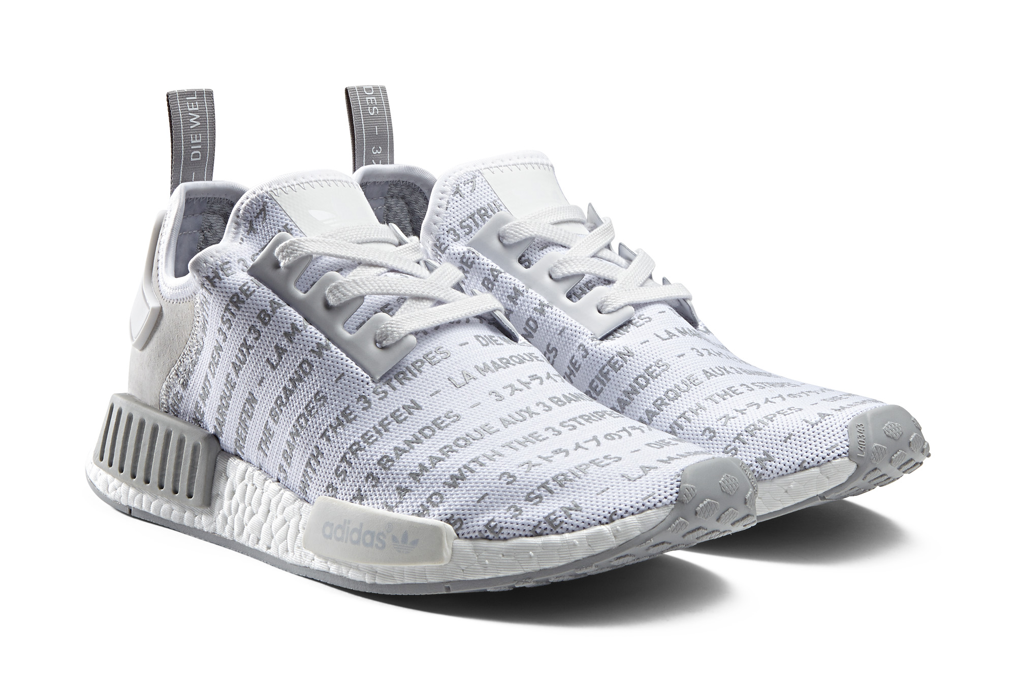 adidas originali nmd blackout / whiteout pack / consorzio